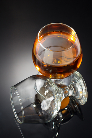 cognac: cognac and  glass on black background