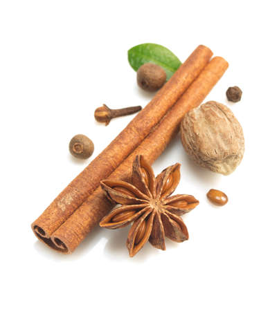 badiane: cinnamon sticks, anise star and other spices on white background