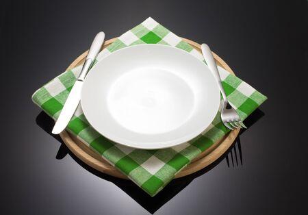 cutting: napkin cloth and cutting board on black background