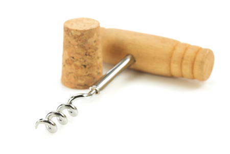 bar ware: corkscrew and wine cork isolated on white background