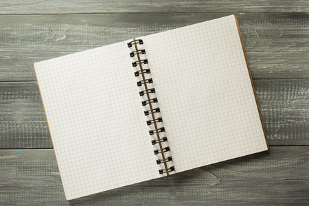 checked: checked notebook on wooden background Stock Photo