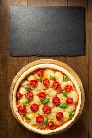 margarita pizza: margarita pizza at wooden table Stock Photo