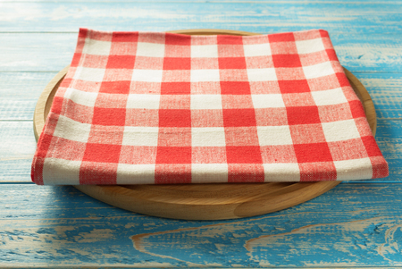 napkin at cutting board on wooden background Stock Photo