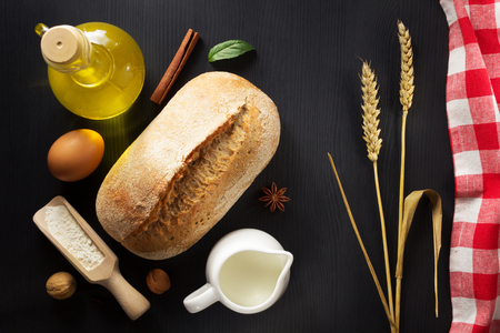 ear checked: bread and bakery  ingredients on wooden background