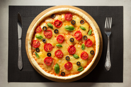 table surface: italian pizza at table surface background Stock Photo