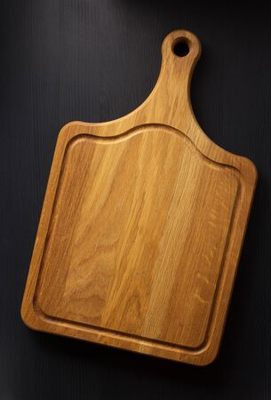 table surface: cutting board at wooden table surface Stock Photo