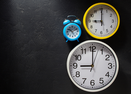 back in an hour: wall clock  at black background  texture