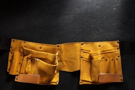suede belt: tool belt on black background