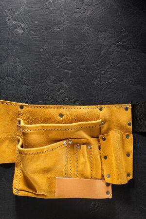 Tool belt on black background Stock Photo
