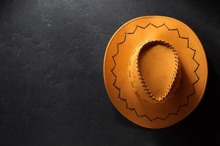 stetson: cowboy hat on black background texture