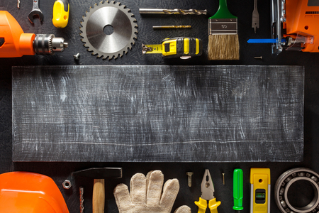 housebuilding: tools and instruments on black background