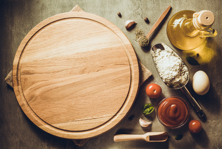 pizza cutting board at table background Stock Photo