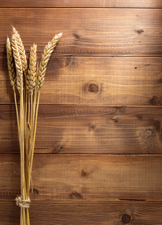 ears of wheat on wooden background Stock Photo