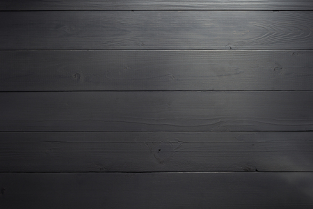 over the counter: black wooden board as background texture