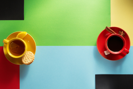 cup of coffee and tea at colorful background Stock Photo
