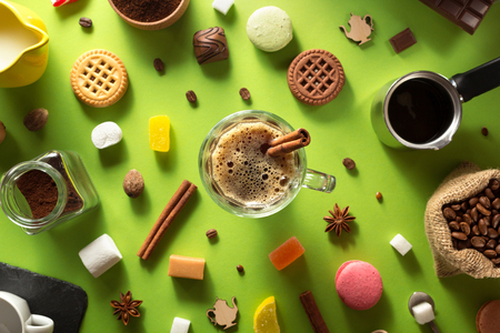 cup of coffee and ingredients at colorful background Stock Photo