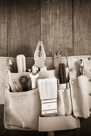 tools and instruments in belt on wooden background Stock Photo