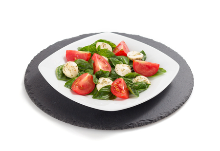 basil, mozzarella and tomato salad isolated on white background Stock Photo