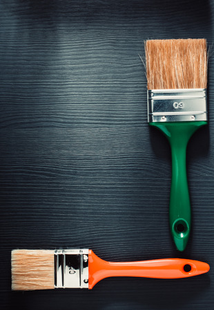 decorating: paint brush on wooden background Stock Photo