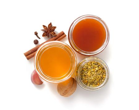 glass jar of honey isolated on white background Stock Photo