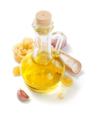 bottle of oil and pasta isolated at white background