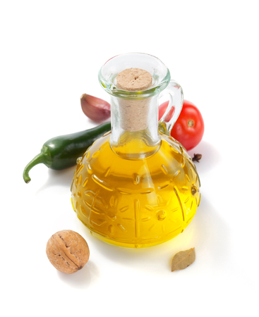 bottle of oil isolated and spices at white background