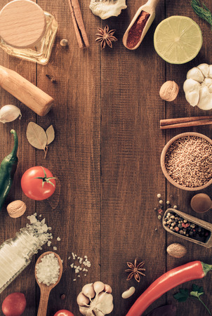herbs and spices on wooden background Standard-Bild