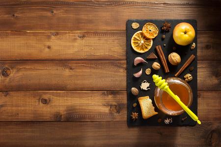 glass jar of honey on wooden background