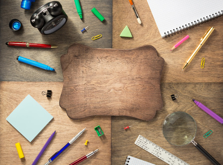 school supplies at abstract wooden background