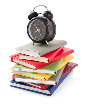 notebooks and alarm clock isolated at white background Stock Photo