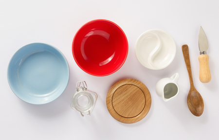 kitchenware set at white background, top view