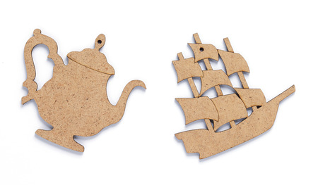wooden ship and tea pot toy at white background, top view
