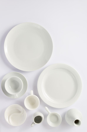 set of dishes on white background, top view