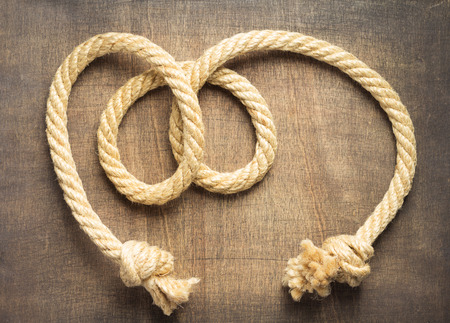 ship rope at wooden background surface Stock Photo