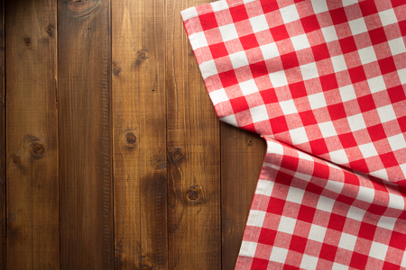Checked table cloth at wooden  surface Stock Photo