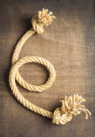 Ship rope at wooden  surface