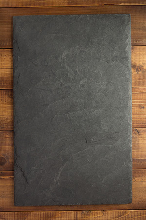 Slate stone at wooden  texture surface
