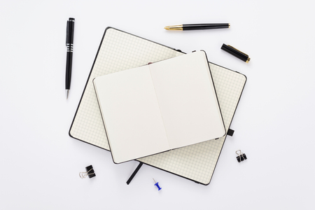 Notebook and stationary at white paper Banque d'images