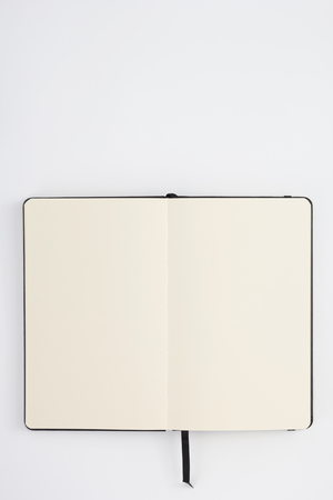 Notebook at white paper