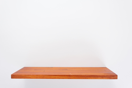 wooden shelf at white background texture wall