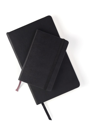 closed notebook or notepad at white background, top view Фото со стока - 120465027