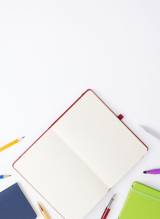 paper notebook and school supplies at white background Banque d'images