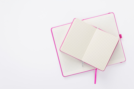 notebook at white paper background, top view