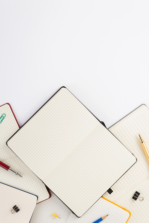 paper notebook and school supplies at white background 写真素材