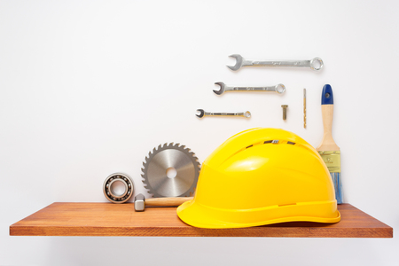 set of tools and instruments on shelf at white background