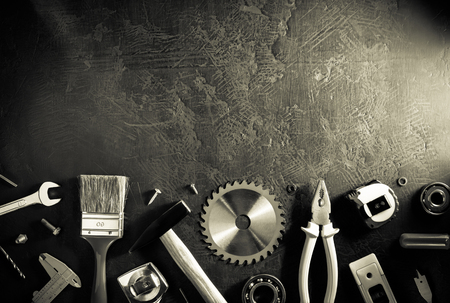 set of tools and instruments on black background