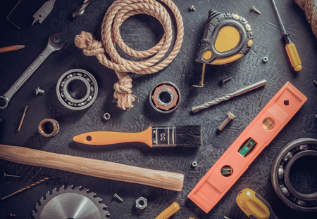 tools and instruments on black table background, top view Stock Photo