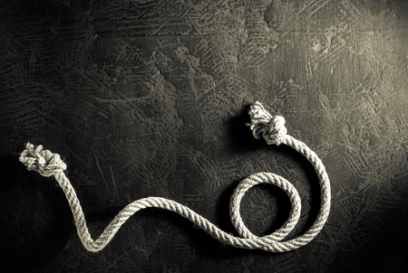 ship rope at black background texture, top veiw