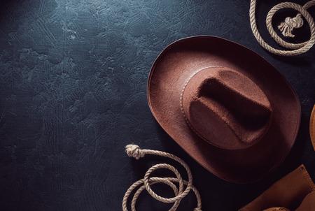 cowboy hat on black table wooden background, top view Reklamní fotografie