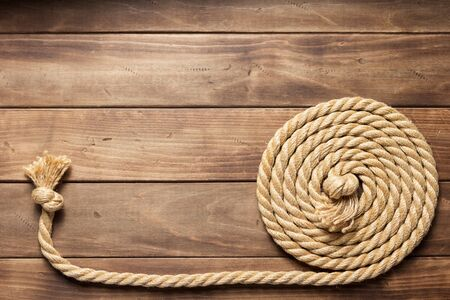 ship rope at wooden background texture, top veiw